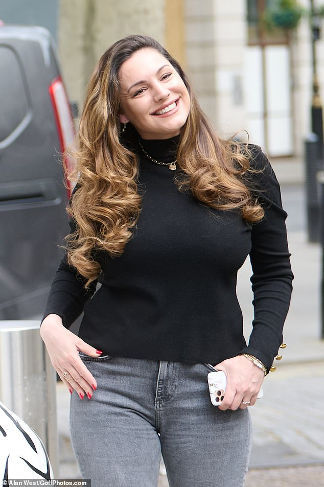 Chic: The 41-year-old presenter dazzled viewers with a beaming smile as she walked towards Global Studios in a black turtleneck and gray ripped jeans
