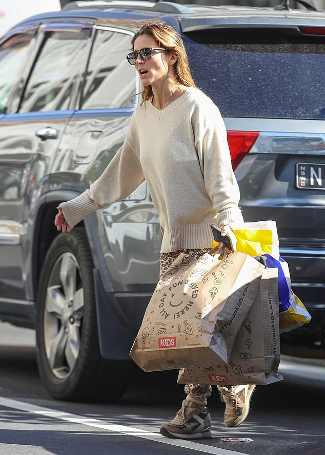 Effortlessly chic:She teamed her look with a pair of sneakers, and wore some oversized sunglasses on her pretty visage