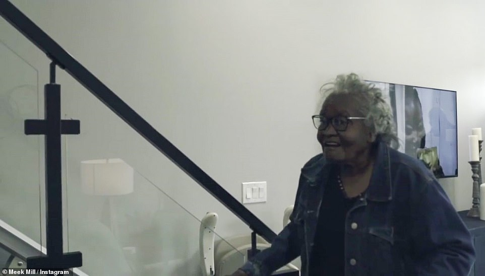 Welcome Home: After showing the bedroom, kitchen and living room, the video shows Grandma - walking with a cane - seeing the house for the first time