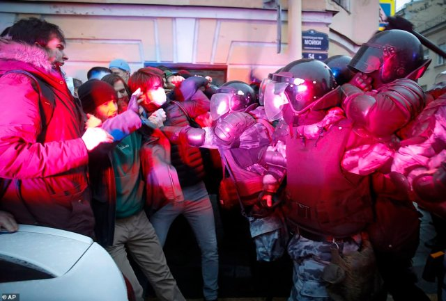 People scuffled with police at a pro-Navalny demonstration in Saint Petersburg. Several people were arrested before the protests even began