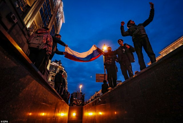 Protesters held Russian flags as they came out in their tens of thousands to demonstrate in support of Kremlin critic Alexei Navalny
