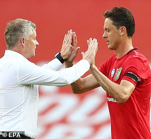 First-team midfielder Nemanja Matic (with Solskjaer, above) also accompanied the coaching staff to talk to angry fans