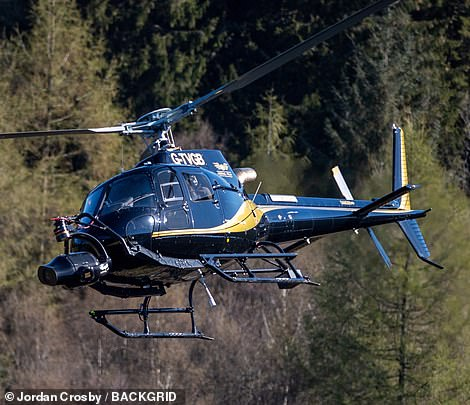 Impressive: A helicopter was also seen flying high above them, filming on a camera that had been mounted onto the front of the cockpit