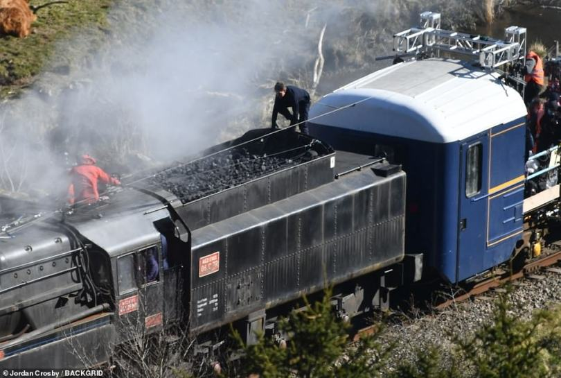 His turn:After Hayley had finished her stunt, it was Tom's turn and he was seen climbing up onto the locomotive before also running full pelt across the coal