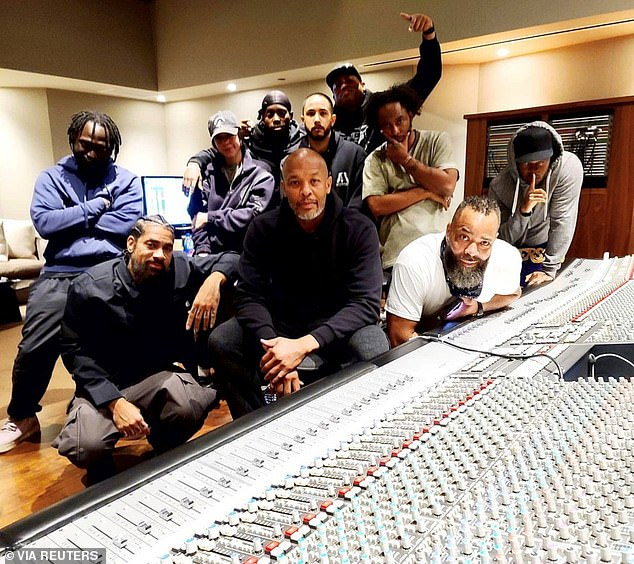 Last week Dr. Dre (pictured in his home studio in January) scored a victory against his estranged wife Nicole Young amid their ongoing bitter divorce