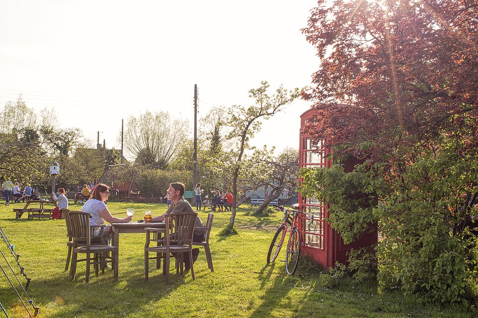 The garden at The Fleece Inn is also an orchard, with its apple trees currently covered in blossom