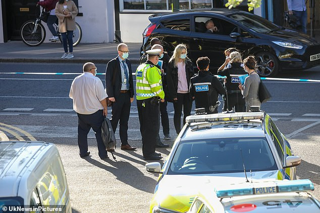 Police flocked to the scene as investigations into how a man died have continued this evening