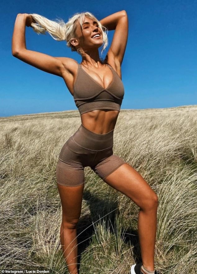In her element:The surfer, 23, caught the eye as she showcased her toned abs in gymwear by Fabletics