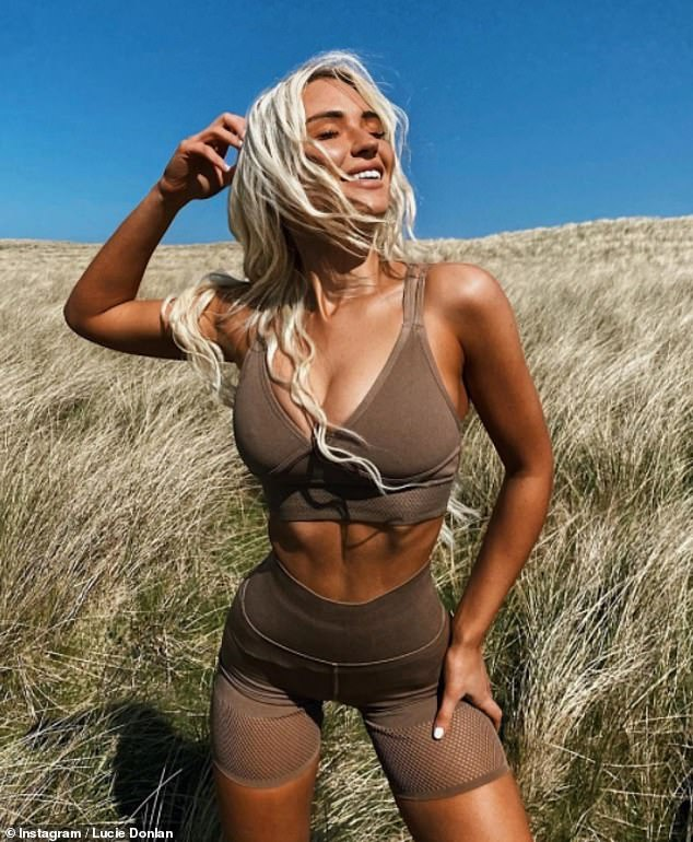 Enviable:Turning up the heat, the reality star teamed a tiny bralet with matching cycling shorts