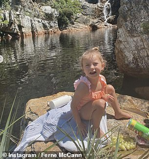 So sweet: reality TV star's daughter beamed as she sat by the water's edge