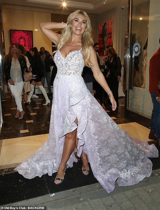 Center stage: Christine McGuinness stepped out in a bride-inspired gown at the Zeynep Kartal launch in London on Thursday