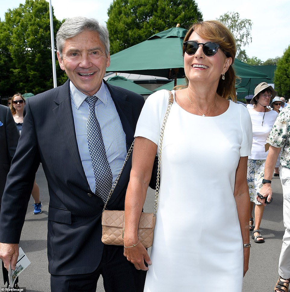 Royal fans have suggested that Prince Louis bears a striking resemblance to Kate Middleton's father, Michael (pictured with Carole Middleton in 2017)