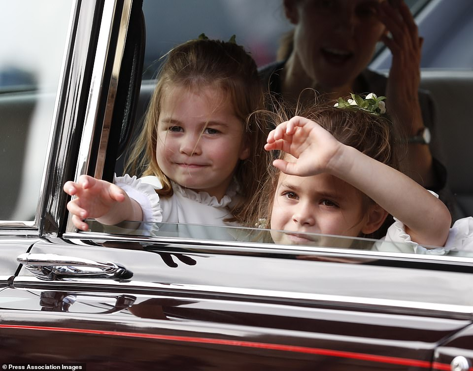 Princess Charlotte waves to the crowds following the wedding of Princess Eugenie of York and Jack Brooksbank in St George's Chapel, Windsor Castle