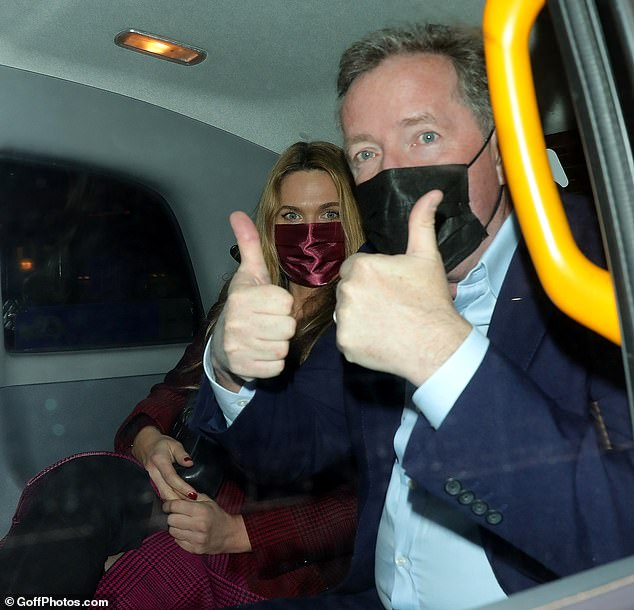 Mr and Mrs: He flashed a thumbs up as the taxi drove away after his dinner with his wife