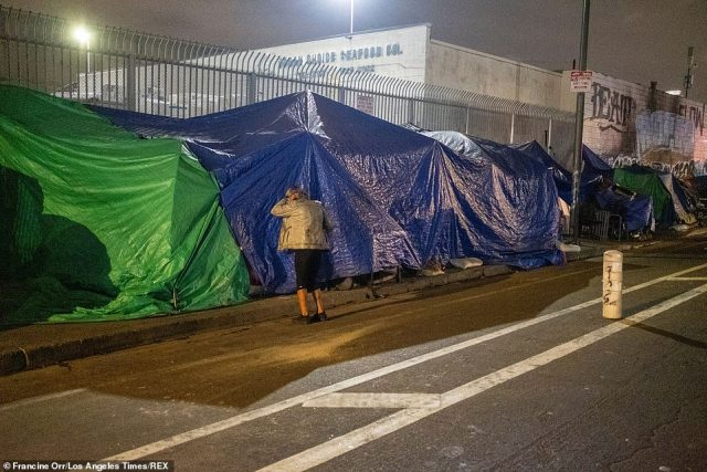 Some rows of tents are covered with tarps to keep them safe from the elements. Much of Skid Row is a 'no go' zone for many people in Los Angeles, even though it's right off the city's central business district
