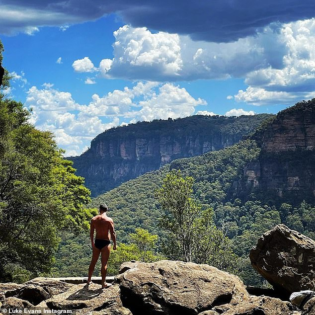 In the wild: Meanwhile, Hobbit star Luke Evans posted a photograph of himself in the Blue Mountains wearing a pair of black swimming trunks
