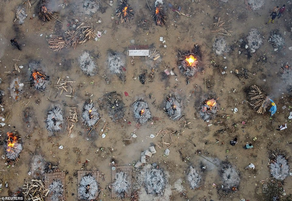 A mass cremation of victims who died due to the coronavirus disease is seen at a crematorium ground in Delhi yesterday evening