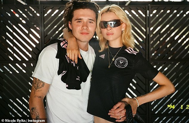 Strike a pose:The Back Roads actress looked flawless for the occasion, sporting an Inter Miami Adidas tee and slim-fitting jeans as she posed with beau Brooklyn and the rest of the group