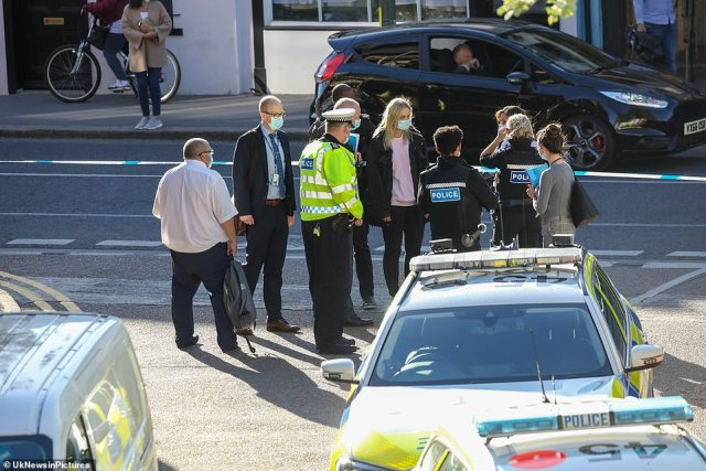 Police flocked to the scene as investigations into how a man died continued yesterday evening