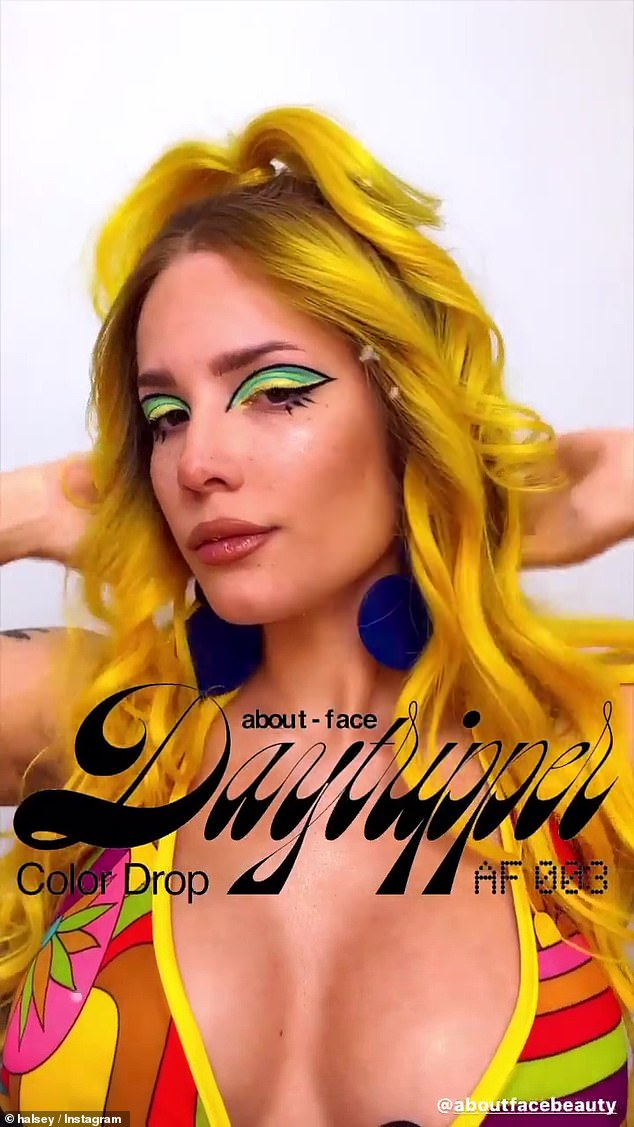 Showstopping:Not surprisingly, her make-up was perfectly applied, with Halsey sporting eyeshadow in hues of yellow and green, with her eyes framed with a striking black trim
