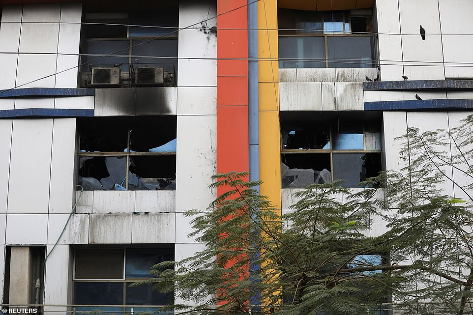 The burnt out hospital in Virar, north of Mumbai, after a fire killed 13 Covid patients, in the latest accident in the country's overcrowded hospitals