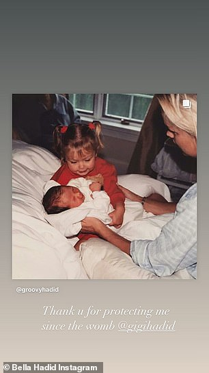 Protector: Gigi was seen cradling her younger sister after she was born as Bella thanked her for 'protecting' her since the womb