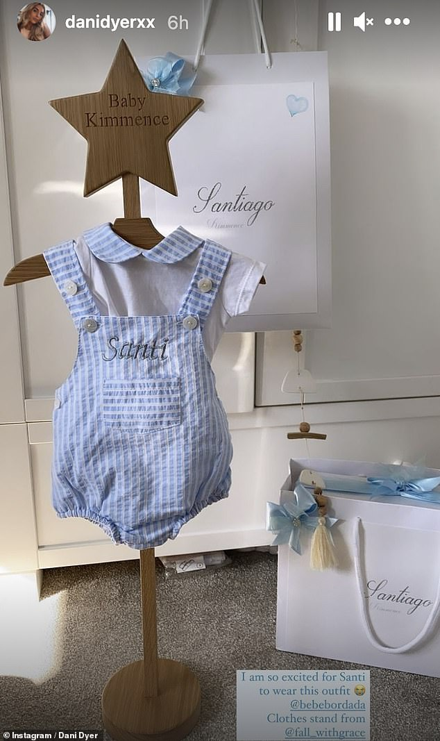 Super cute: Dani also shared a snap of a very trendy new summer outfit for Santi displayed on a 'baby Kimmence' stand