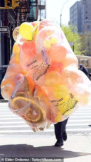 Balloons: A hefty bunch of balloons that read '26' along with others were seen being ushered into her Soho space