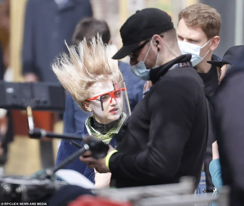 Break: Maisie wrapped up warmly in a black padded coat and took cautious measures amid the Covid crisis by wearing a plastic visor.