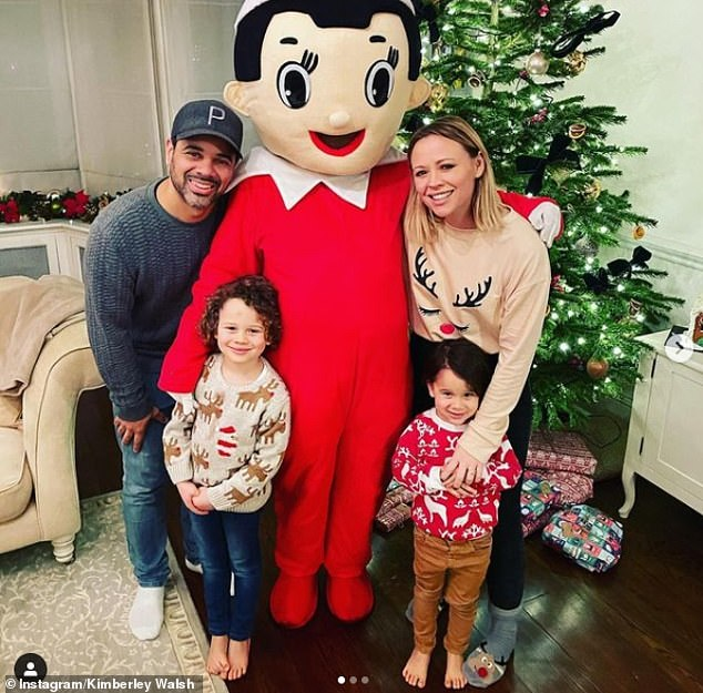 Happy family: Kimberley confirmed last December she and Justin were expecting their third child (pictured with sons Bobby and Cole)