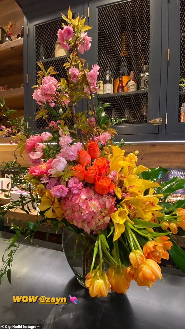 Flower power: And partner Zayn Malik surprised her with a stunning bouquet of flowers that took her breath away as she marveled 'WOW'