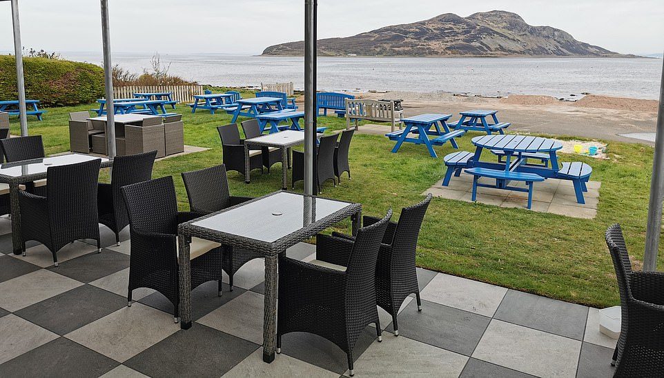 The beer garden at The Drift Inn on the Isle of Arran has views out toLamlash Bay, Holy Island and the Firth of Clyde
