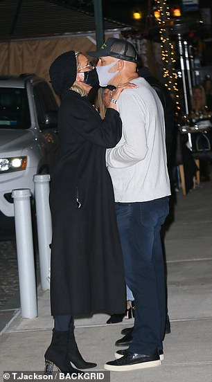Masked kissing: The girls' mother, former Real Housewife Yolanda Hadid, was seen canoodling with beau Joseph Jingoli