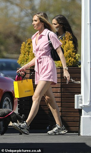 Shopping spree? It seemed that Megan had also been indulging in some retail therapy as she carried a yellow Selfridges bag in her hand