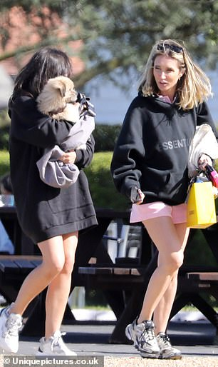 Casual chic: Megan put on a leggy display in the thigh-grazing garment, which she later layered up with a black Essentials hoodie