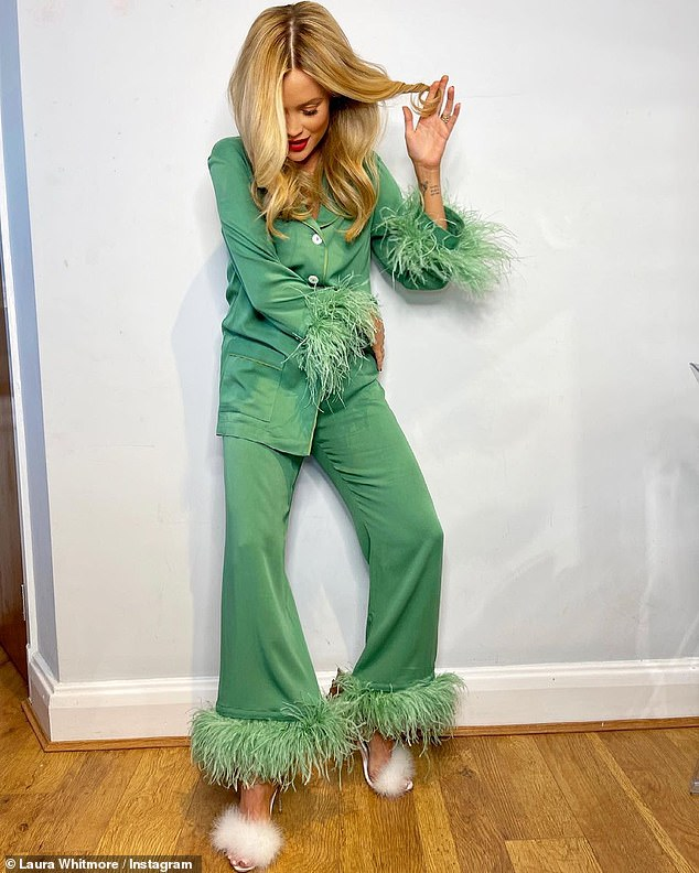 Stunning:Laura Whitmore looked typically sensational as she donned green feathered co-ords three weeks after giving birth to their baby girl
