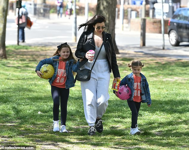 Stepping out:Imogen Thomas stepped out with her two children at a local park in London on Saturday amid her ex Ryan Giggs' court proceedings