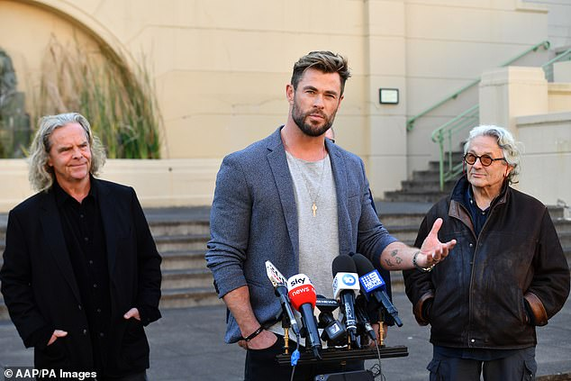Chris Hemsworth was used by scammers to look like he endorsed Bitcoin (pictured, at the Mad Max film announcement on Monday)