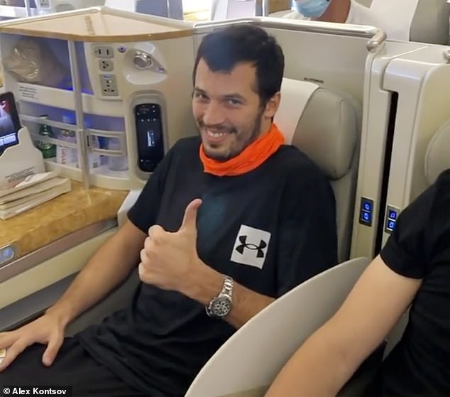 Grechin admitted there was another picture inside his Russian friend Alexei Kontsov's (pictured on board flight to Moscow) apartment showing Grechin surrounded by 20 naked women as he played the piano