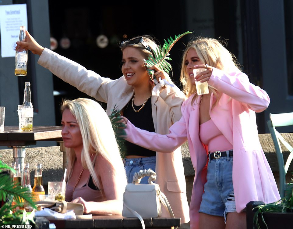 Cheers: Drinkers in Leeds headed to bars and beer gardens to enjoy the sun during the second weekend since rules eased