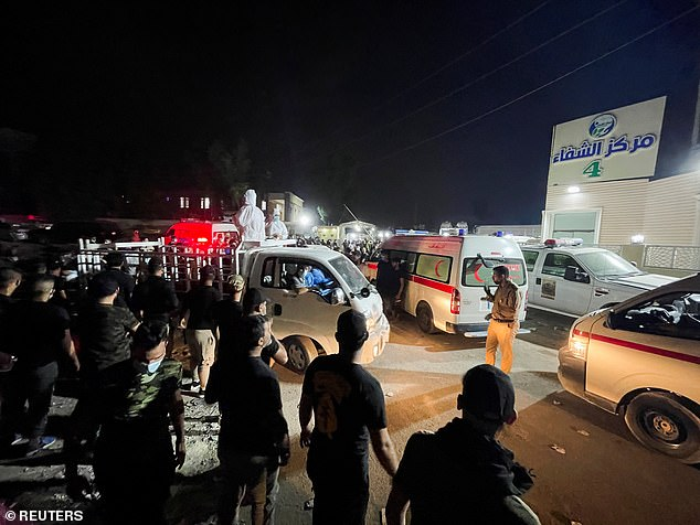 Scores of ambulances were rushing towards the hospital, ferrying those hurt by the fire, a Reuters photographer nearby said