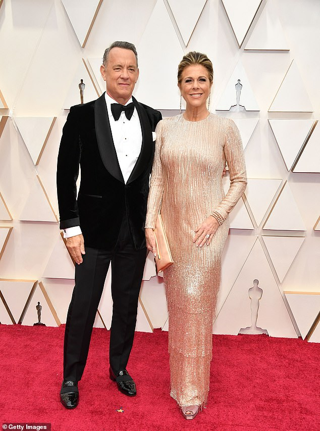 Partial masking:The show appears to be trying to downplay the use of masks, as presenters won't wear them when on camera, but they will be required to have them on during commercial breaks; Tom Hanks and Rita Wilson seen in 2020