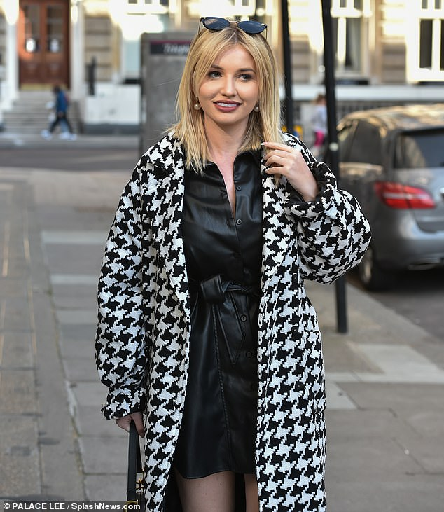 Looking good: Amy Hart was sure to command attention as she headed to lunch with pals in London on Sunday