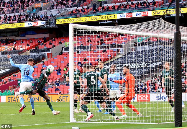 City beat Spurs on Sunday afternoon via Aymeric Laporte's (left) last-gasp header at Wembley