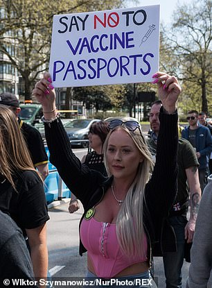 With political opposition mounting and the virus in retreat, Mr Johnson is understood to be turning against the idea. Pictured: Demonstrator at an anti-lockdown protest in London on Saturday