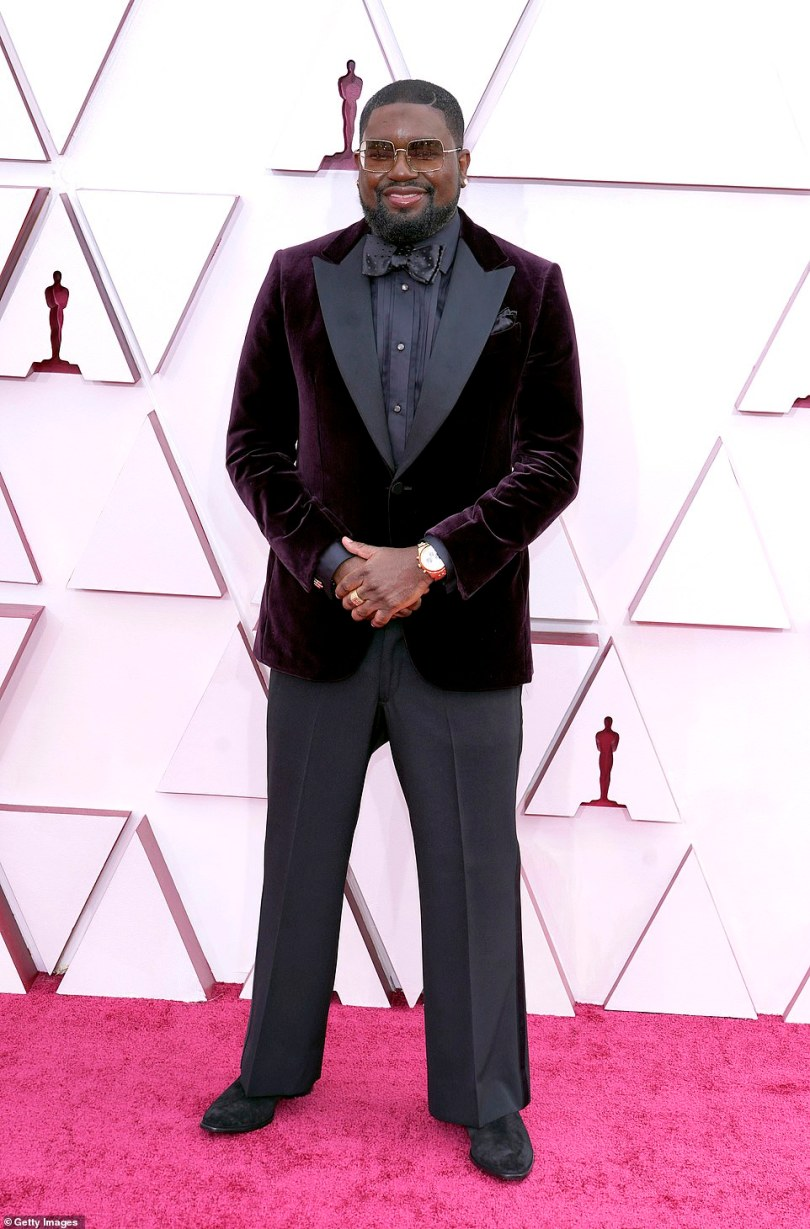 Suited and booted: Lil Rel Howery arrives at the Oscars in a velvet black blazer with matching shirt and bow tie