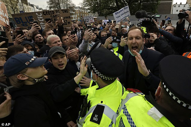 Petr Cech (right) appeared to try and appease angry Chelsea fans protesting against the ESL