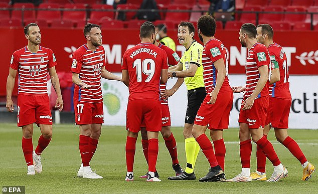 Sevilla's tie with Granada ended in chaos as the referee ended the match a minute early