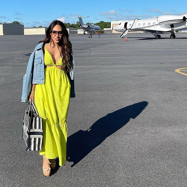 Neon dream:For the second leg of her trip Gorga got glam in a neon yellow dress, posing on the tarmac as she captioned her snap: 'You Ready?!'