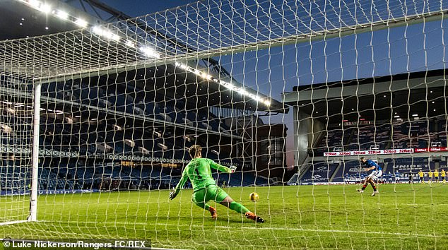 St Johnstone goalkeeper Clark saves a penalty from Rangers' Kemar Roofe in the shoot-out